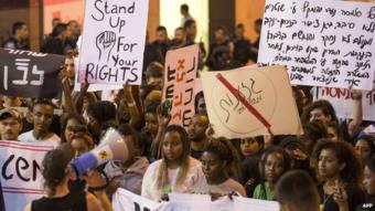 Israelis from the Ethiopian community take part in a protest against alleged police brutality and institutionalised discrimination in Haifa in May 2015