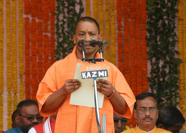 FILE PHOTO: India's ruling Bharatiya Janata Party (BJP) leader Yogi Adityanath takes the oath as the new Chief Minister of India's most populous state of Uttar Pradesh during a swearing-in ceremony in Lucknow, India, March 19, 2017.