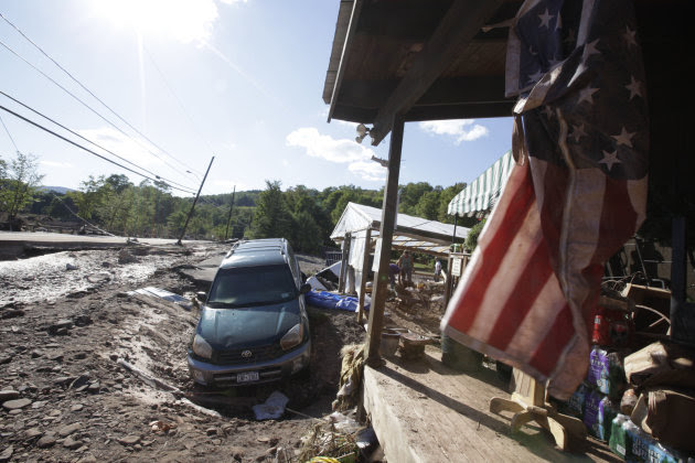 A car lies in a ditch in front of the Country Store a after being dragged by the Batavia Kill stream after Tropical Storm Irene flooded parts of the town, Tuesday, Aug. 30, 2011 in Windham, N.Y. Offic