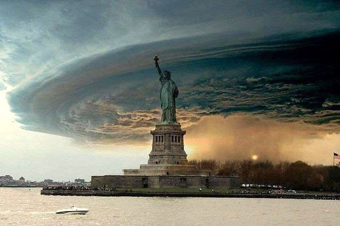 A (fake) image of Hurricane Sandy providing an ominous backdrop behind the Statue of Liberty.
