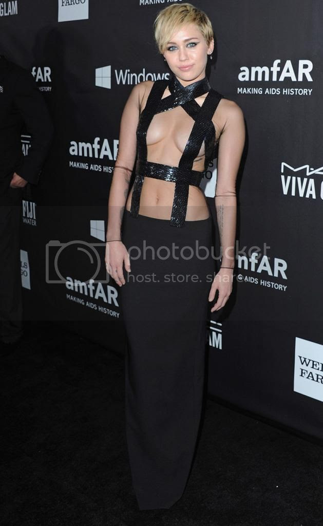 Miley Cyrus and Rihanna at amfAR's Gala photo miley-cyrus-amfar-2014-tom-ford.jpg