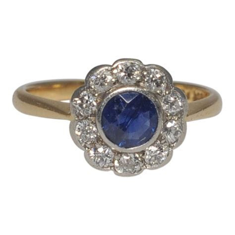 Sapphire and Diamond Halo Engagement Ring  SOLD   Plaza