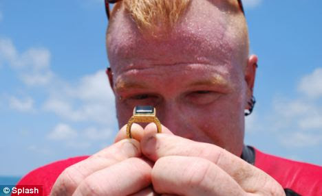 What a find! One of the divers from Mel Fisher's Treasures shows off the ring