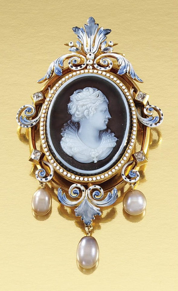 GOLD, ONYX CAMEO, ENAMEL, PEARL AND DIAMOND, PENDANT/BROOCH, LATE 19TH CENTURY.  Inset to the centre with an oval onyx cameo carved to depict the dextral profile of a maiden in Renaissance dress, within an open work scroll frame of blue and white enamel, embellished with circular-cut diamonds, suspending three pearl drops, to a glazed locket reverse.
