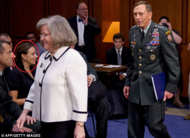 Insult: A photograph in June 2011 shows Broadwell watching as Petraeus and his wife Holly arrive for a Senate Select Intelligence Committee hearing on Petraeus' nomination to be director of the CIA