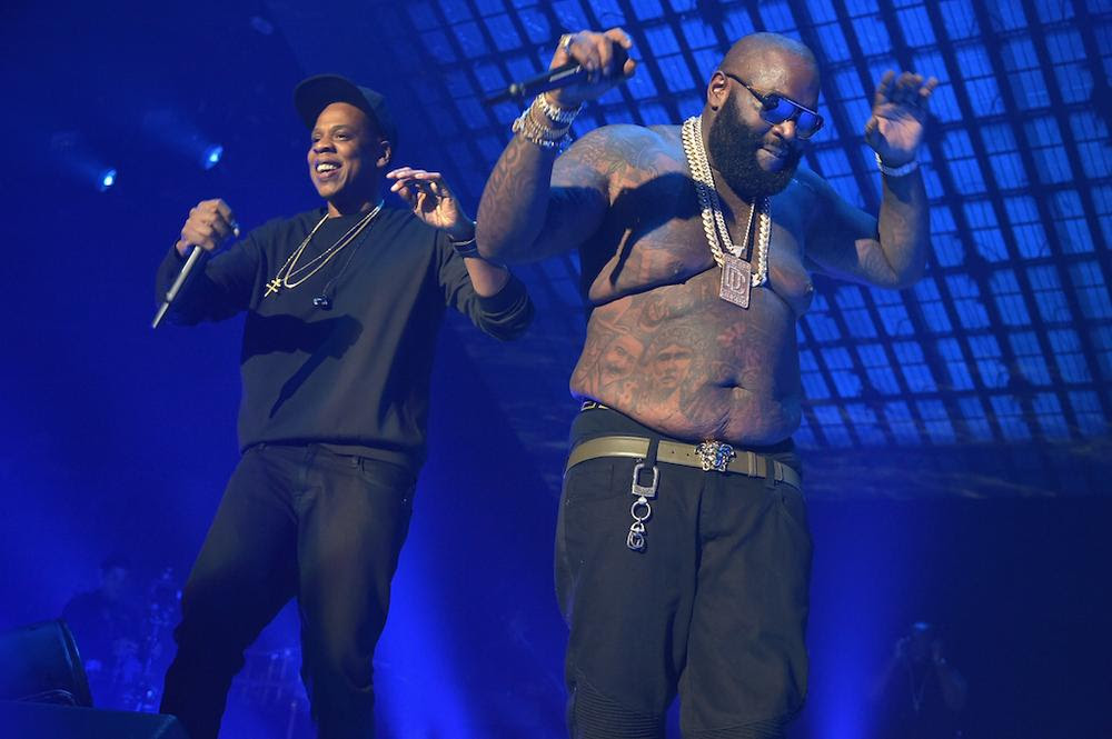 NEW YORK, NY - OCTOBER 20: Rappers Jay-Z (L) and Rick Ross perform onstage during TIDAL X: 1020 Amplified by HTC at Barclays Center of Brooklyn on October 20, 2015 in New York City. (Photo by Theo Wargo/Getty Images for TIDAL)