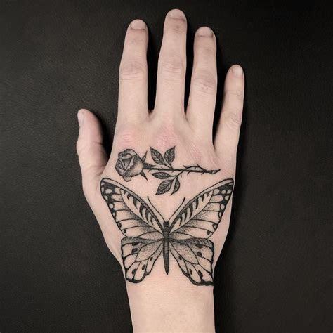 hand small butterfly rose tattoo tattoo design