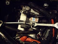 loosen the battery tie down