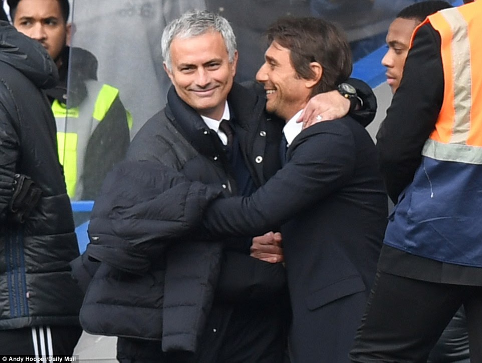 Mourino (left) and Conte were happy to see each other before the big match got under way on Sunday afternoon