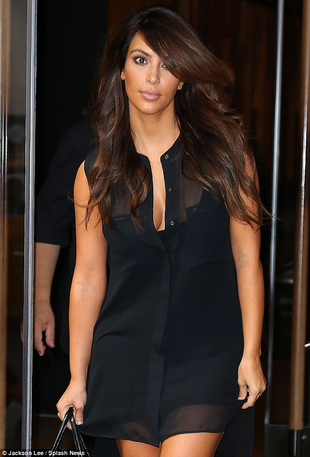 In the sheer: Kim Kardashian slipped on another transparent outfit as she stepped out in New York today