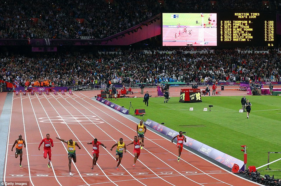 Global appeal: Some 80,000 spectators in the Olympic Stadium watched the 100-metre race, as well as an estimated worldwide television audience of up to two billion