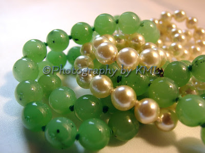 a jade and pearl necklace entwined