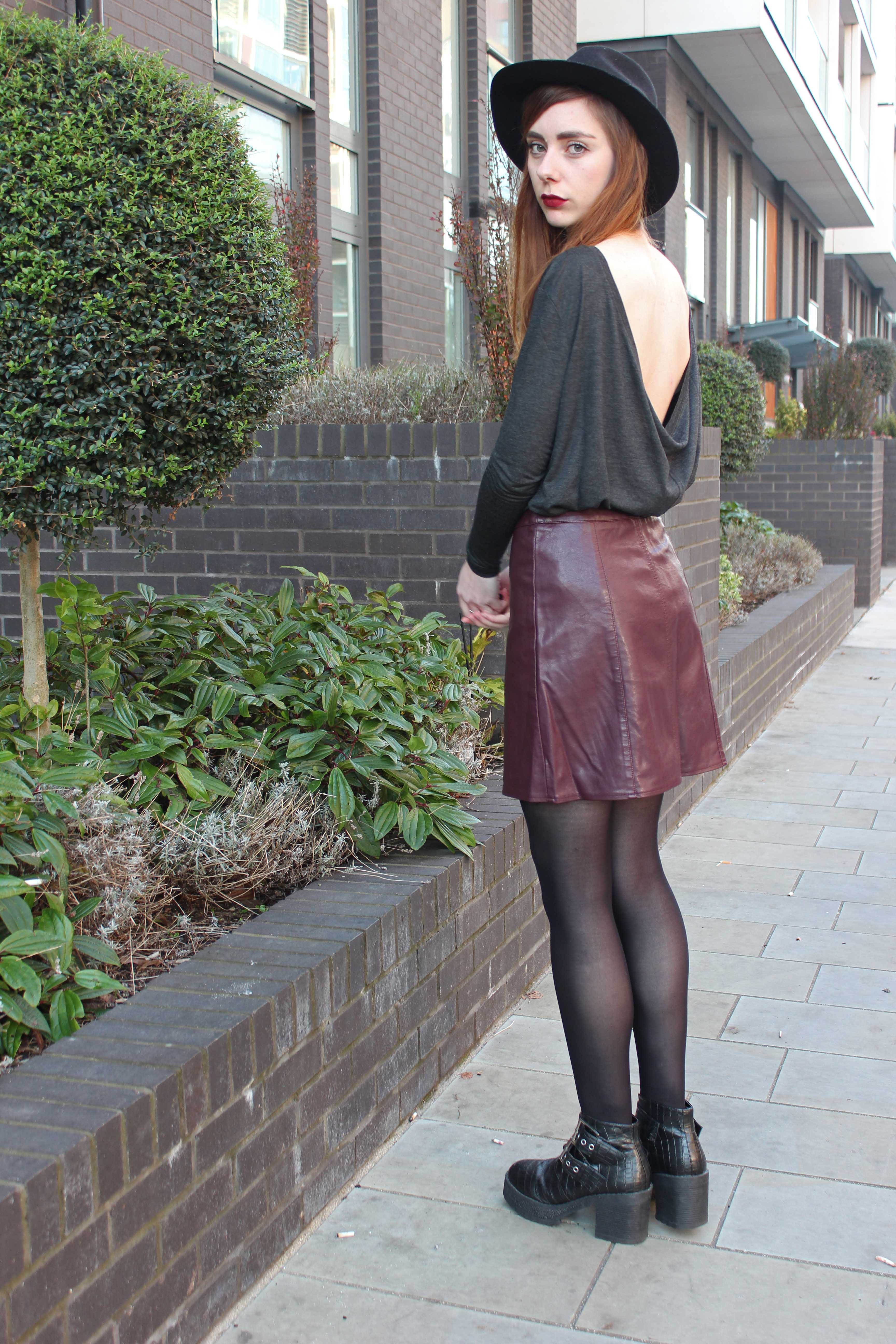 Outfit featuring a scoop back top, leather look skirt and a fedora