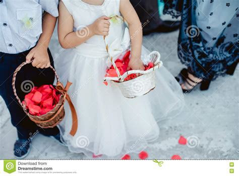 Children With Basket Throwing Rose Petals Royalty Free
