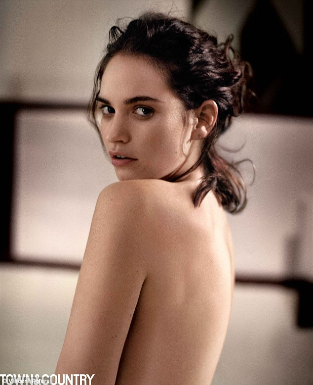 Flashing the flesh:Lily James has proved it is not all fancy frocks and prudish petty coats as she posed for a suggestive new shoot for Town And Country magazine