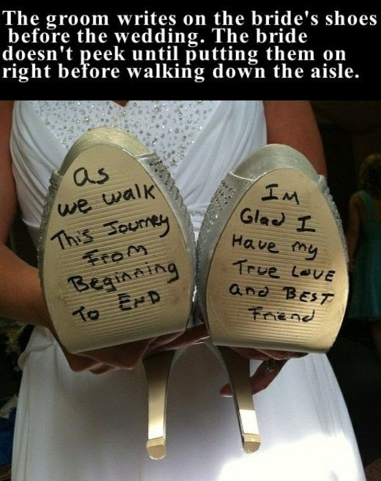 The Groom Writes On The Brides Shoes Before The Wedding Pictures