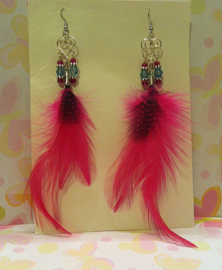 Hot Pink Love Earrings Hot pink feathers & brilliance crystals hanging from silver tone hearts.Hypoallergenic $6.00
