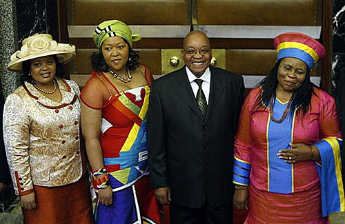 President Jacob Zuma poses for photographs his three wives, Sizakele MaKhumalo (right), Nompumelelo Ntuli (left) and Thobeka Mabhija (second left), after the State of The Nation address in Parliament on June 3. by Pan-African News Wire File Photos