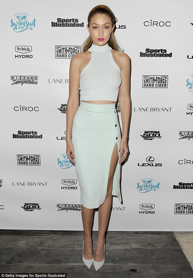 Co-ord queen: Gigi, 20, flashed a whole lot of leg in a pastel thigh-high split skirt which she teamed with a white ribbed crop top