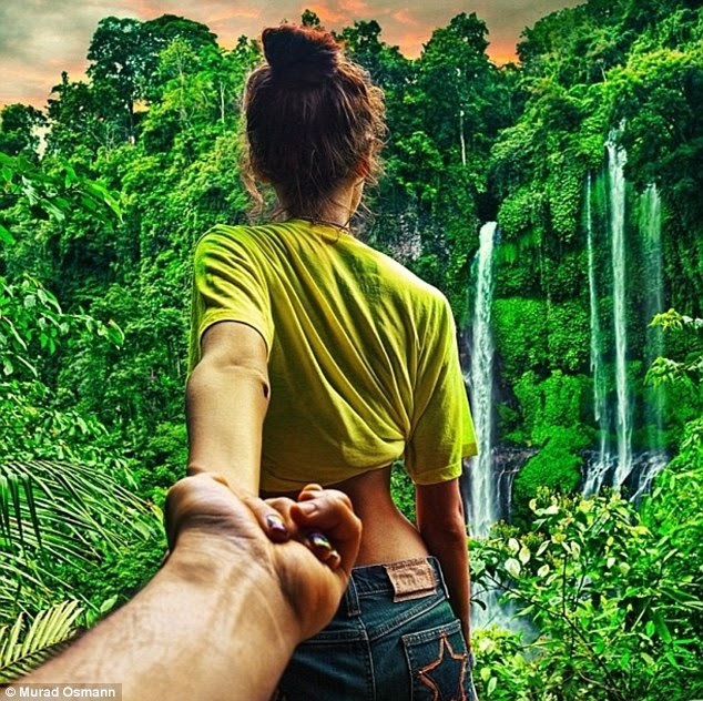 The couple stand in front of a rainforest scene. Murad works as an executive producer for film company Hype Productions