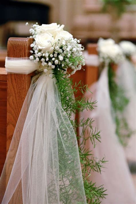 Cost effective church pew décor: Baby's breath with blush