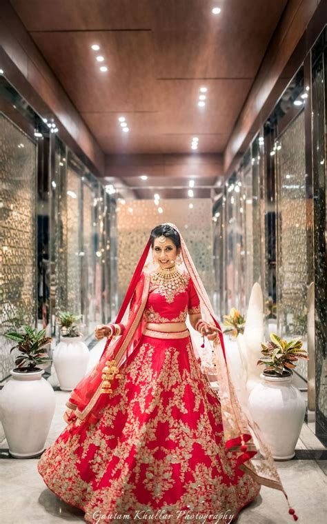 Red and gold bridal lehenga with zardozi work , twirling