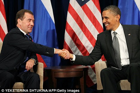 All smiles: Russian president Dmitry Medvedev (L) meets with U.S. President Barack Obama on the sidelines of the APEC summit in Hawaii