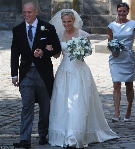 Give us a kiss! Newlyweds Zara Phillips and Mike Tindall