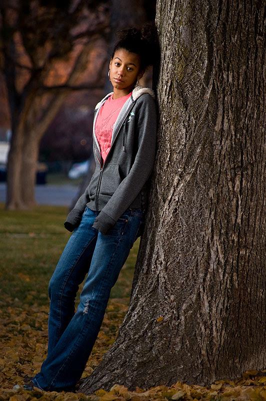 Sad against a tree