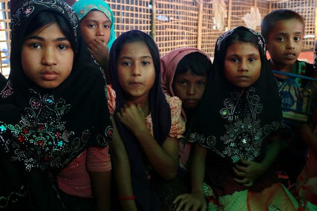 Rubina (extreme left) along with her friend at the Islamic School at Kutupalong camp, home to Rohingya refugees from Myanmar. Credit: Farid Ahmed/IPS