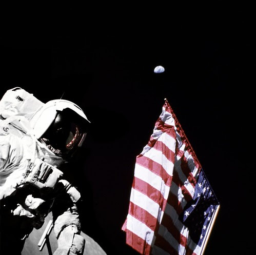 Schmitt with Flag and Earth Above by NASA Goddard Photo and Video