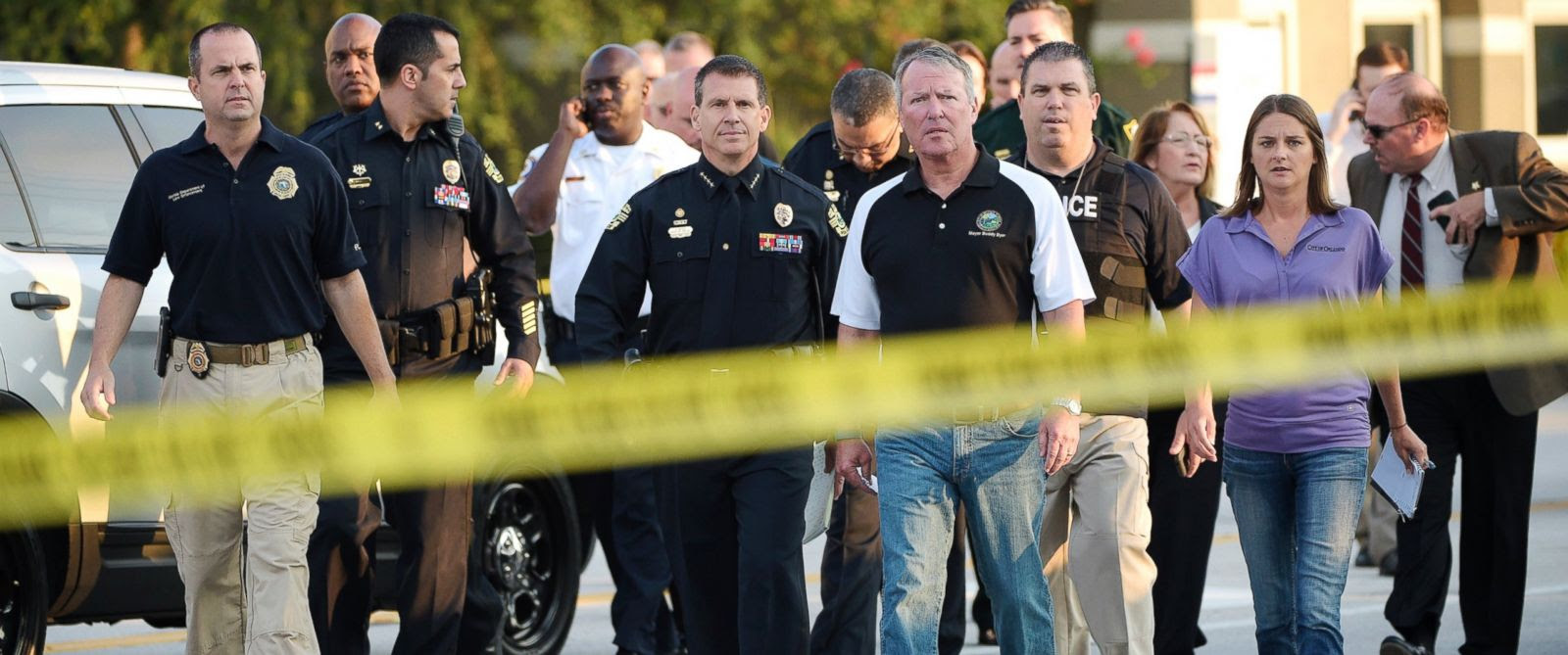 PHOTO: Orlando Mayor Buddy Dyer, center right, and Orlando Police Chief John Mina, center left, arrive to a news conference after a fatal shooting at Pulse Orlando nightclub in Orlando, Fla., June 12, 2016.