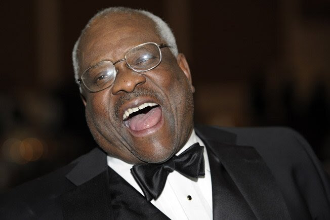 Supreme Court Justice Clarence Thomas laughs at The Federalist Society's 2011 Annual Dinner in Washington on Nov. 10, 2011.