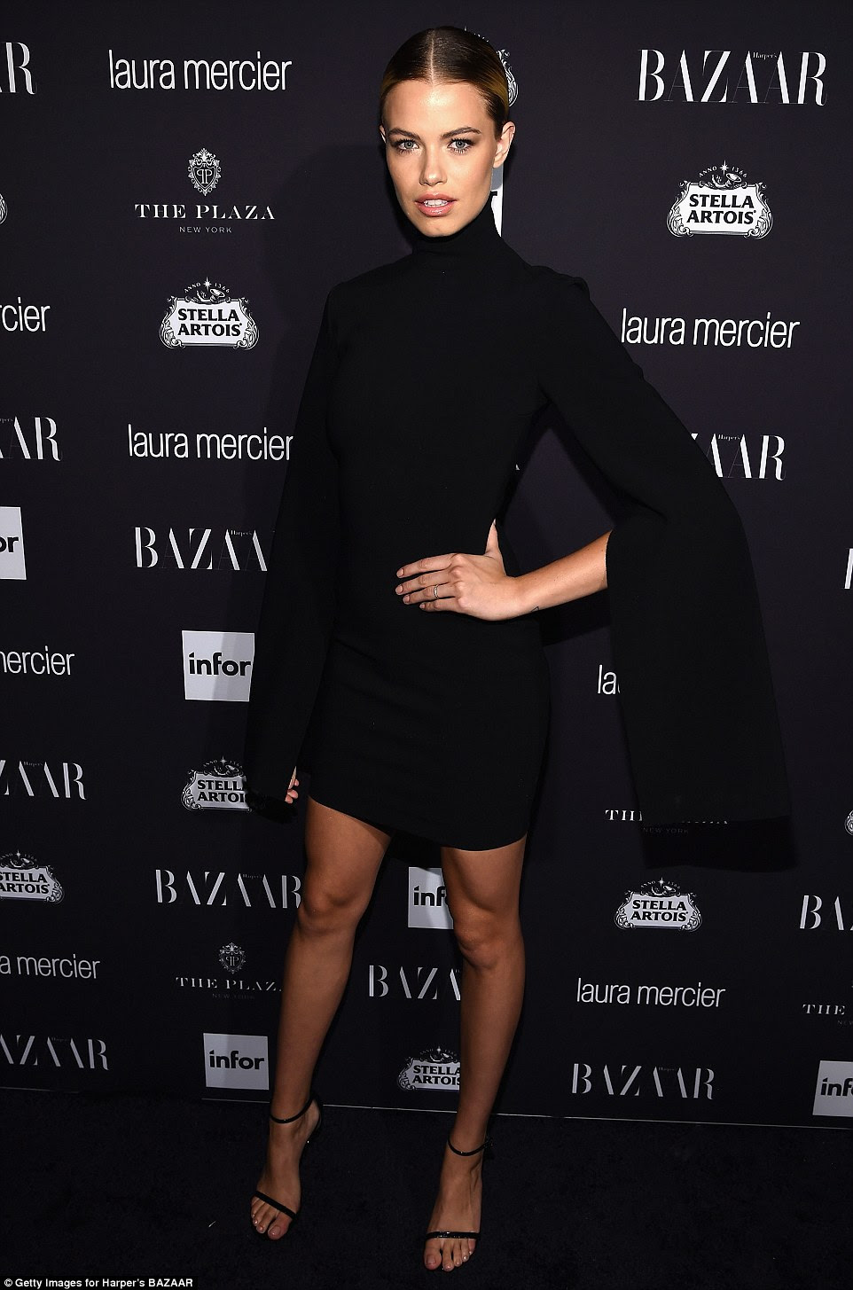 All black everything: Sports Illustrated cover girl Hailey Clauson looked every inch a vixen as she hit the carpet in a black cape dress
