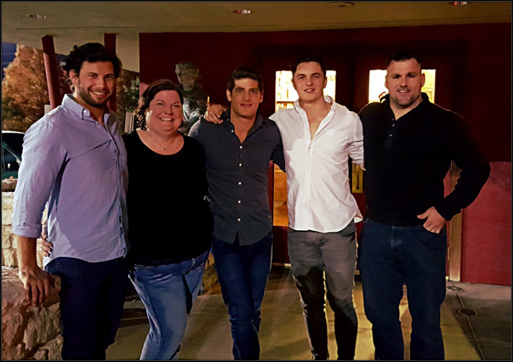 Author Lorraine Britt with members of the Griffins Rugby Squad