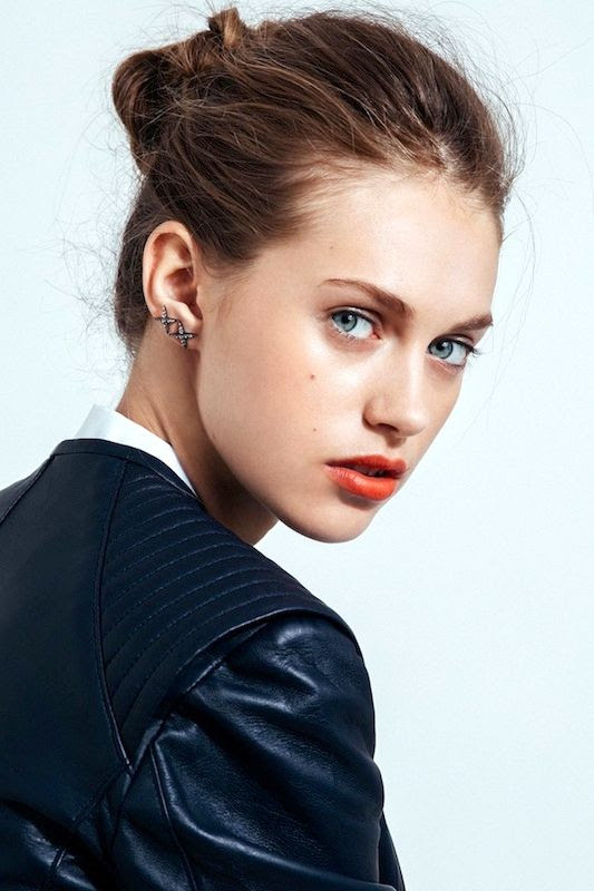 Le Fashion Blog 5 Easy Hairstyles For When You're Running Late Short On Time Lazy Girl Hair Messy Twisted Bun Red Orange Lips Cross Earrings Via Refinery29
