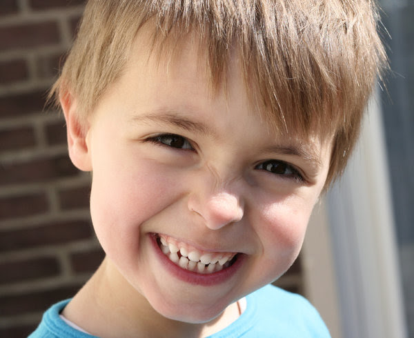 say cheese: little four year old smiling