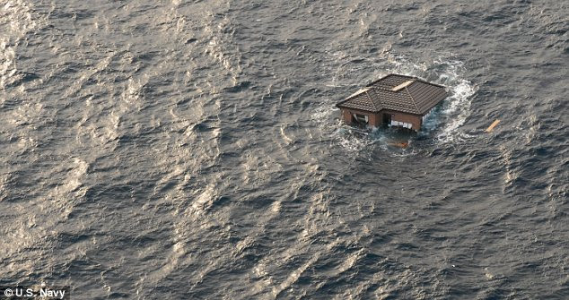 Adrift: A whole house bobs in the Pacific Ocean off the coast of Japan. An enormous field of debris was swept out to sea following the earthquake and tsunami