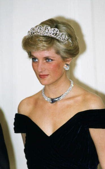 Princess Diana wearing a diamond & sapphire necklace, a