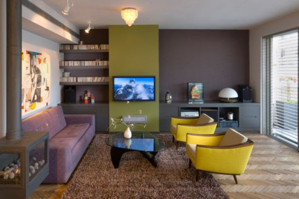 Living room featuring a brown accent wall with an ochre focal ...