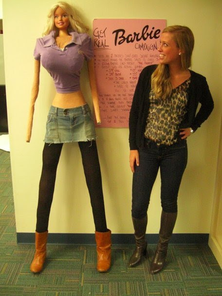 Galia Slyen with her life-size Barbie (via huffingtonpost.com)