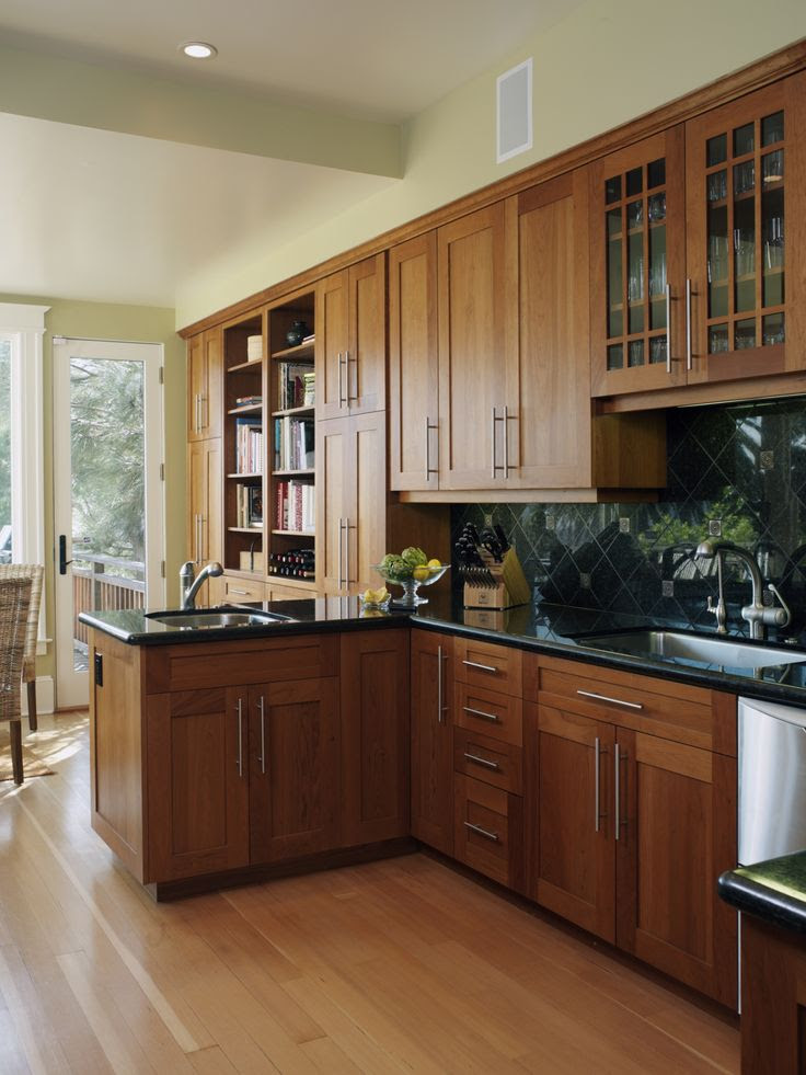 Oak cabinets with black countertops.   For the Home ...