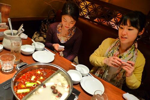 Iyo and Maiko preparing to eat hot pot
