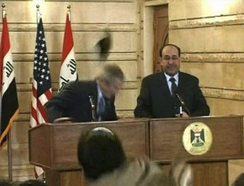 In this image from APTN video, an man throws a shoe at President George W. Bush during a news conference with Iraq Prime Minister Nouri al-Maliki on Sunday, Dec. 14, 2008, in Baghdad. The man threw two shoes at Bush, one after another. Bush ducked both throws, and neither man was hit. (AP Photo/APTN)