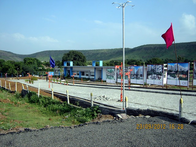 Office - Pristine City 20 Acre Township of 1 BHK & 2 BHK Flats at Bakori Wagholi Pune 412 207