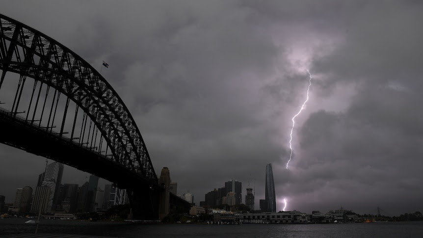 Wild weather over Sydney brings thunder, lightning, hail and heavy rain after tornado warning
