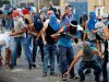 Jerusalem Arabs rioters clash with police in the neighborhood of Issawiya on Tuesday.