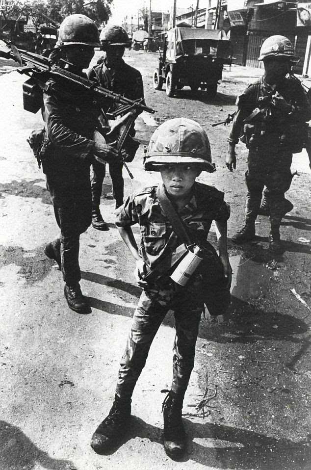 """""""This Vietnamese child was nicknamed 'Little Tiger' for allegedly killing two 'Viet Cong women cadre' - his mother and teacher."""""""