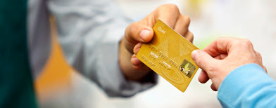 Paying with a credit card (Corbis)