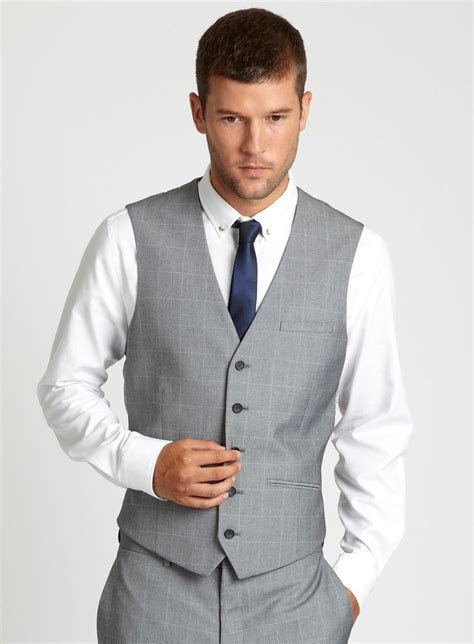 again, grey waistcoat and navy blue tie. Hope can get